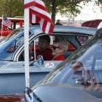 Joan Couch, 75, a retired flight attendant at Delta, from Perry, Georgia, sits in her 1964 Corvair Monza with her husband, Tommy Couch, 73, car lot owner from Oxford, Mississippi, at the Georgia National Fair in Perry, Georgia, on Saturday, October 10,  2015. The couple met at a car show and were married four and a half years ago. (Photo/Hannah Kicklighter)