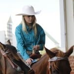 Claire Waldrop, 15, an equestrian from Oglethorpe, Georgia, prepares for a performance with the Southern Sweethearts riding group at the Georgia National Fair in Perry, Georgia, on October 10, 2015. (Photo/Catherine Braun; catybird@uga.edu)
