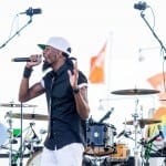 """A member of the family band known as Kazual sings to the crowd at the Georgia National Fair on Saturday, October 10, 2015, in Perry, Georgia. Kazual is a band of three brothers and their cousin that mixes the sounds of R&B, hip hop, and pop together to create the """"Kazual"""" experience, according to their website. (Photo/Lauren Taylor Watt, lwatt@uga.edu)"""