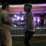 Gary Hughes, 26, from Fort Valley, Georgia, dances and sings with performer Natalie Stovall during Travis DenningÕs performance at the Georgia National Fair in Perry, Georgia, on Saturday, October 10, 2015. Hughes and Stovall knew each other from meeting at the fair a previous year. (Photo/Maggie Harney, mkharney@uga.edu)