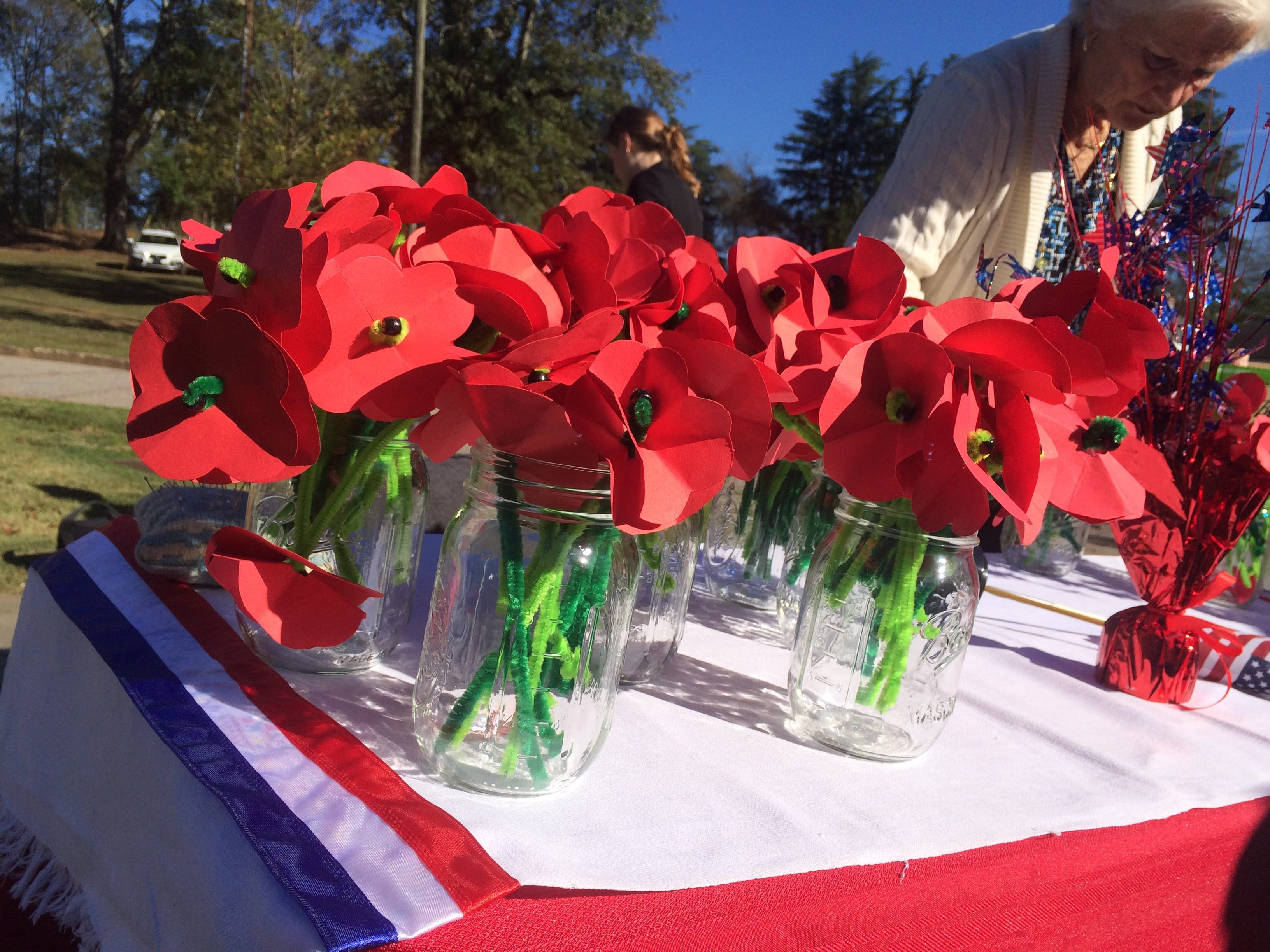 Homemade poppy pins await guests at the Veteran's Day ceremony at Oconee Hill Cemetery.
