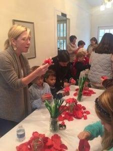 Children make poppies for Veterans Day.