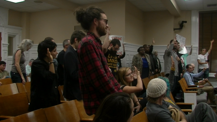 Citizens stand in support of Living Wage Policy