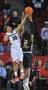 Georgia guard J.J. Frazier (30) saves the ball from going out of bounds during the Bulldog's game with the Oakland Grizzlies at the Stegeman Coliseum on Tuesday, December 1st, 2015 in Athens, Ga. (Photo by Sean Taylor)