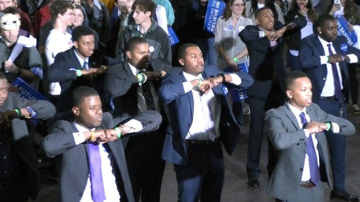 Omega Psi Phi fraternity members perform step show before Bernie Sanders' rally