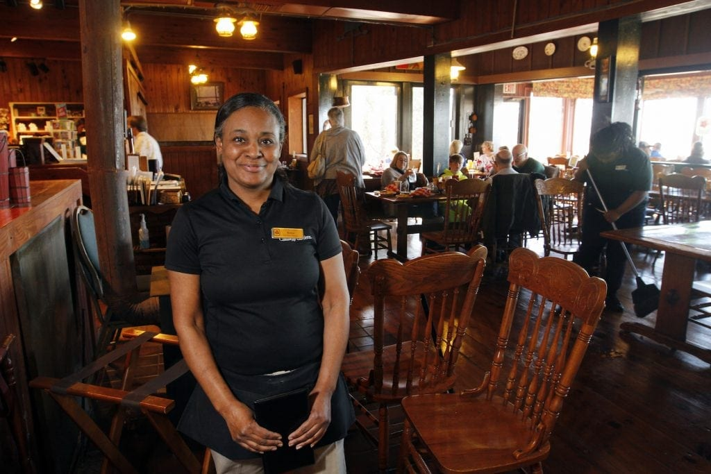 Renee Kimbrough, 52, from Talbotton, Georgia, has worked as a server at The Country Kitchen for 31 years. She poses in the restaurant after a busy Saturday lunch shift.  Photograph at The Country Kitchen in  Athens, Georgia, on Saturday, February 27, 2016. (Photo/Caroline R. Elliott, creneee@uga.edu) Kimbrough: (706) 663-2281
