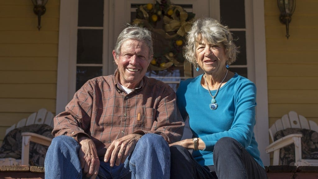 Bill Birkhead, a 74-year-old retired professor from Providence, Rhode Island, and his wife of over 50 years Faith Birkhead, a 73-year-old retired artist from Long Island, New York, pose for a portrait on their property in Hamilton, Georgia. The two have lived there together for more than 30 years. (Photo/Jenny Goldberger, www.jennygoldberger.com)