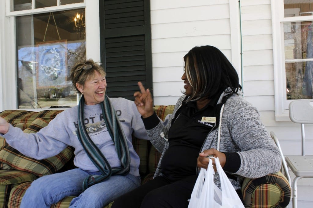 Sherrie Mundy, 55, the thrift store manager from Columbus Georgia talks to a customer in Hamilton, Georgia, on Saturday, February 27, 2016. Sherrie enjoys chatting with customers throughout the day. (Photo/Lauren Leising, lel57623@uga.edu) Sherrie Mundy- (706) 628-9955