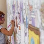 Liliana Alarcon, 5, from Warner Robins, Georgia, colors on a community coloring wall at the Georgia National Fair in Perry, Georgia, Saturday, October 8, 2016. The Georgia National Fair attracts thousands of people every year for the various events. (Photo/Austin Steele, steeleau@uga.edu)