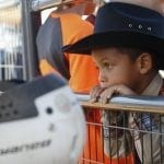 Jayden Martinez, 5, from Byron, Georgia, waits to participate in the Mutton Bustin' event at the Georgia National Fair in Perry, Georgia, Saturday, October 8, 2016. Mutton Bustin is a competiton for kids to see who can ride the sheep for the longest amount of time. (Photo/Austin Steele, steeleau@uga.edu)