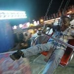 Troyquavian Thomas, 7, a child from Arlington, Georgia, rides a swing ride on Saturday, October 8, 2016, in Perry Georgia. The rides, games and large variety of food options at The Georgia National Fair offer families and fair-goers a fun and unique day. (Photo: Lauren Leising/lel57263@uga.edu)