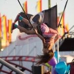 Kori Pugh, age 6, from Leesburg, Georgia, flips on a jumping attraction at the Georgia National Fair in Perry, Georgia, on Saturday, October 8, 2016. Pugh and her family drove down for the day, like many families, to spend quality time together. (Eva Claire Schwartz, evacschwartz@gmail.com)