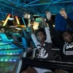 Kashanti Lemon, 13, and Dymond Brown, 13, two eighth grade students from Sandersville, Georgia, ride a roller coaster on Saturday, October 8, 2016, at the Georgia National Fair, in Perry, Georgia. Lemon and Brown travel from Sandersville to Perry together every year to experience the fair.  (Photo/Ansley Walker)