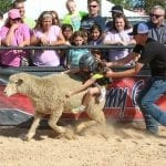Elizabeth Smith, 6, from Kathleen, Georgia, a young competitor in the Mutton Bustin' Wool Riding competition at the Georgia National Fair in Perry, Georgia, on Saturday, October 8, 2016. Smith was taken off of the sheep after a bad start at the beginning of her round in the sheep riding competition. (Photo: Henry Taylor/henrytaylorphoto@gmail.com)