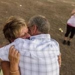 "Christine Bartley, 54, of Long Island, New York, and Joseph Follmer, 57, of Jersey City, New Jersey, embrace while a family member records the moment after Bartley proposed to Follmer at the Georgia National Fair in Perry, Georgia, on Saturday, Oct. 8, 2016. Bartley and Follmer met in Ocala, Florida, where they both now reside, after Bartley's daughter, Cassandra, set her up with Follmer, a maintenance worker that works in the building where she lives. ""They went out for coffee and [have] been inseparable since,"" says Cassandra. But when recollecting their first meeting, Follmer admitted, ""we still haven't had our first coffee date."" When they met up before going to get coffee, they talked for so long that they forgot to go. (Photo/Casey Sykes, www.caseysykes.com)"