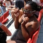 Tacarra Williams, 21, a senior psychology major at the University of Georgia from Dallas, Georgia, tries on her NASA certified eclipse viewing glasses over her normal glasses during the eclipse viewing party in Sanford Stadium at the University of Georgia in Athens, Georgia, on Monday, August 21, 2017. (Photo/Dori Butler)