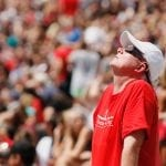 Robert McConnell looks up at the sky during the eclipse viewing party in Sanford Stadium in Athens, Georgia, on Monday, August 21, 2017. (Photo/Emily Haney)