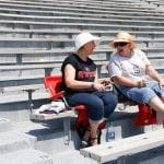 Barbara Cotes, 60, a retired educator from Alpharetta, Georgia, (left) sits with her friend Jeanie Whitworth, 61, a retired educator from Gainesville, Georgia, (right) at the eclipse viewing event in Sanford Stadium in Athens, Georgia, on Monday, August 21, 2017. (Photo/Kristin M. Bradshaw)