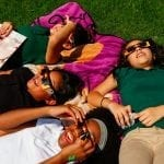 "Students of Coile Middle School enjoy an outside break to watch the solar eclipse on Monday, August 21, 2017 in Athens, Georgia. Descriptions of the eclipse among students were ranging from "" a croissant, like the bread"" to ""a toenail,"" in reference to the crescent-like shape the sun and moon produce during an eclipse. (Photo/Steffenie Burns)"