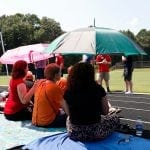 Teachers relax under umbrellas during the eclipse viewing party at Cedar Shoals High School in Athens, Georgia, on Monday, August 21, 2017. (Photo/McGee Nall)