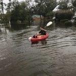 Luke Fucetola of Saint Simons Island, GA kayaks down a street flooded with up to three feet of water on Monday, Sept. 11, 2017. (Photo courtesy of Luke Fucetola)