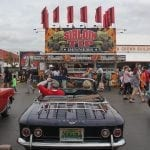 Classic cars line the street at the Georgia National Fair on Saturday, October 7, 2017, in Perry, Georgia. Fairgoers pass by in the background just before the cars prepare to leave. (Photo/Marlee A. Middlebrooks)