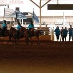 The Georgia Stampede Mounted Drill Team rides around the arena during a competition at the Georgia National Fair in Perry, Georgia, on October 7, 2017. The team is made up of riders from numerous middle Georgia counties. (Photo/ Catherine Green)