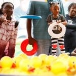 Andre Haynes and his daughters from Atlanta, Georgia, try to throw a Frisbee on rubber ducks to win a grand prize of a stuffed animal, in Perry, Georgia, at the Georgia National Fair, on October 7, 2017. The Georgia National Fair takes place in Perry Georgia, and is the largest fair in the state. (Photo/Grason Passmore)