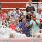 Fairgoers cheer on the pigs of Robinson's Racing Pigs and Pig Paddling Porkers as they dive into the pool during a race at the Georgia National Fair in Perry, Georgia, on October 7, 2017. (Photo/Catherine Green)