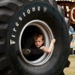 Brantley Ballinger, 6, from Thomaston, Georgia, takes a break in the wheel of a monster truck at the Georgia National Fair in Perry, Georgia, on October 7, 2017. (Photo/Gabriella Cammarata)