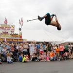 Fred Grzybowski, an entertainer from Rittman, Ohio, does a backflip on a pogo stick in front of a crowd at the Georgia National Fair in Perry, Georgia, on Saturday, October 7, 2017. Grzybowski holds multiple world records for his pogo stick stunts. (Photo/Nicole M. Adamson)
