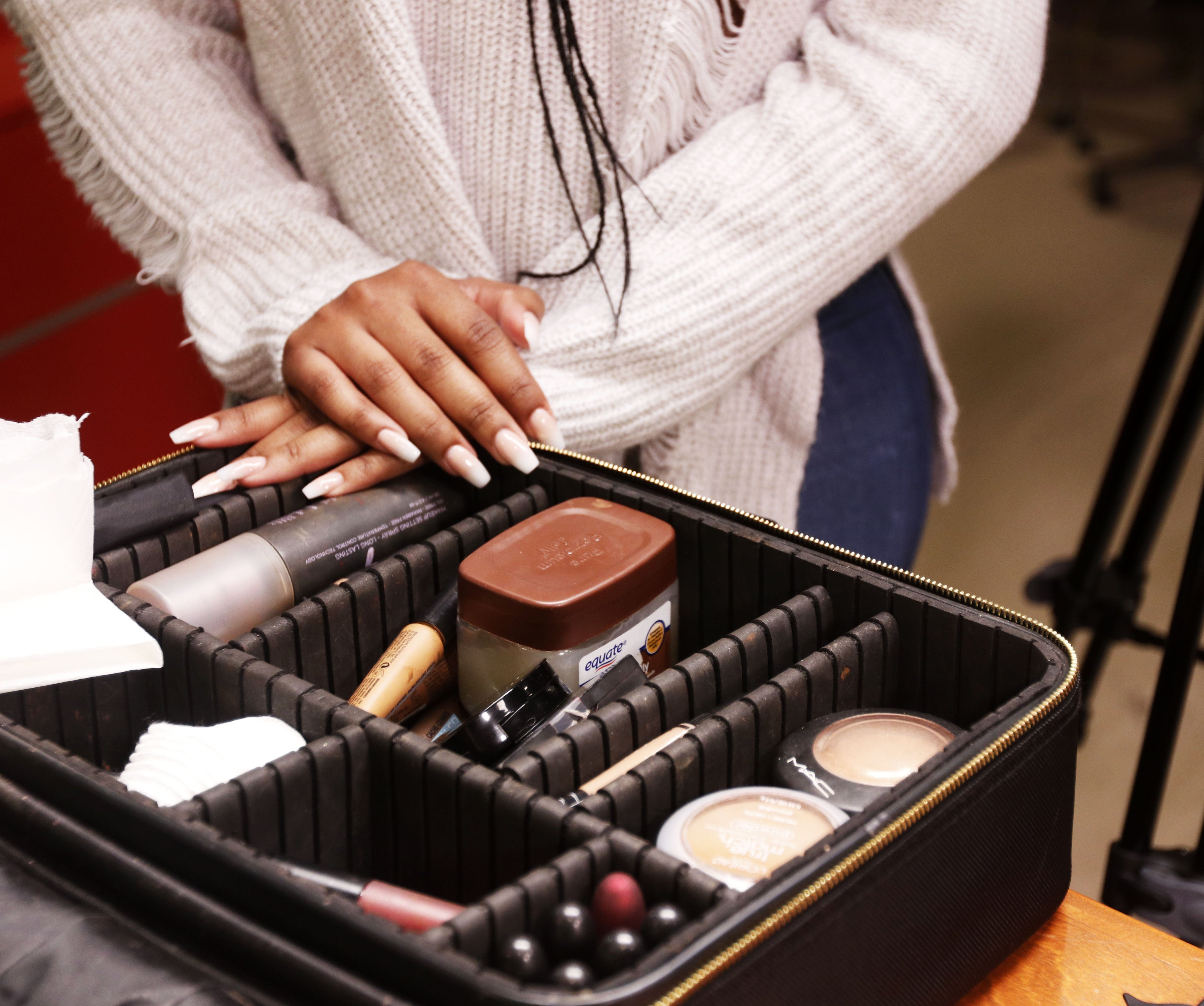 Johnna Young's makeup kit. Young brought it to the studio to give reporter Enya Spicer a prom-style makeover.