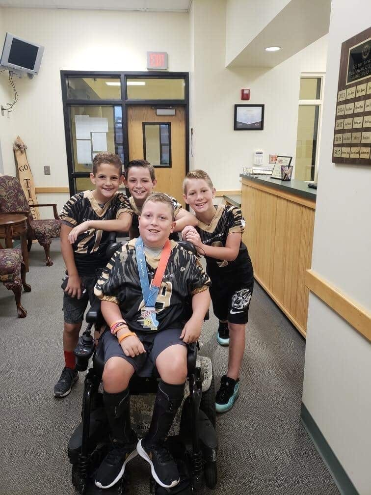 Commerce Youth Football Players Help Friend Achieve His Dream