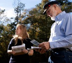 Marilyn Cole, 38, from Savannah, Georgia, and Jim Ford, 74, from Pasadena, Maryland, go door to door in Athens, Georgia, on Saturday, November 3, 2018. Cole began canvassing in 2014 for Michelle Nunn, and Ford has never canvassed before. (Photo/Whitley Carpenter, wcc53060@uga.edu)