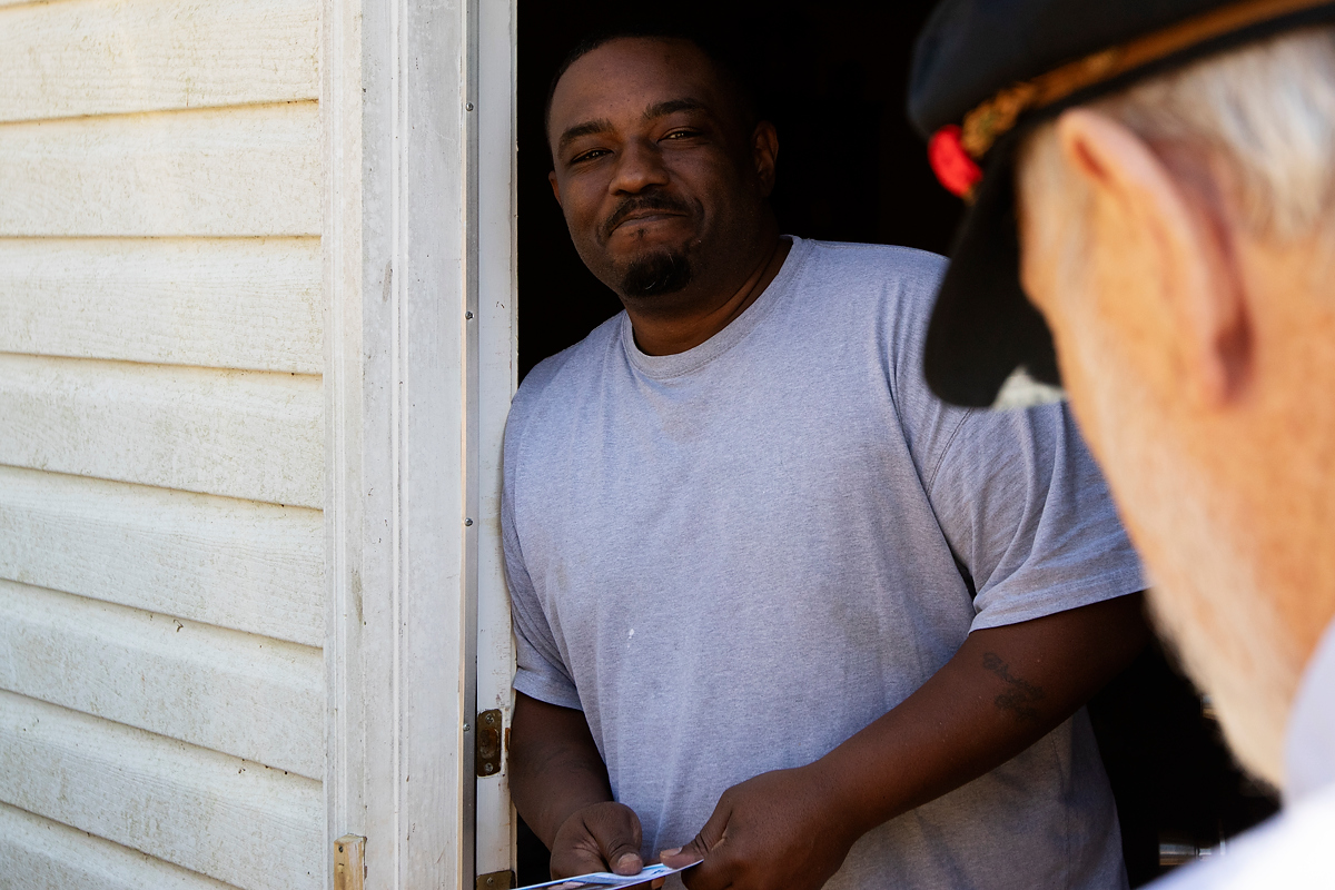 "Corey Griffin, 41, from Miami, Florida, talks to Jim Ford in Athens, Georgia, on Saturday, November 3, 2018. Griffin works as a driver's helper for UPS, and he hasn't decided how to vote. ""I'll have to see how it goes. One side wants to balance the checkbook, and the other side wants to reduce crime,"" Griffin said. (Photo/Whitley Carpenter, wcc53060@uga.edu)"