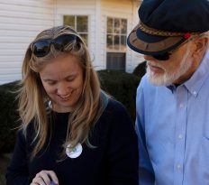 Marilyn Cole, 38, from Savannah, Georgia, and Jim Ford, 74, from Pasadena, Maryland, check their list of houses in Athens, Georgia, on Saturday, November 3, 2018. Cole has been canvassing for four years, and Ford has never canvassed before. (Photo/Whitley Carpenter, wcc53060@uga.edu)