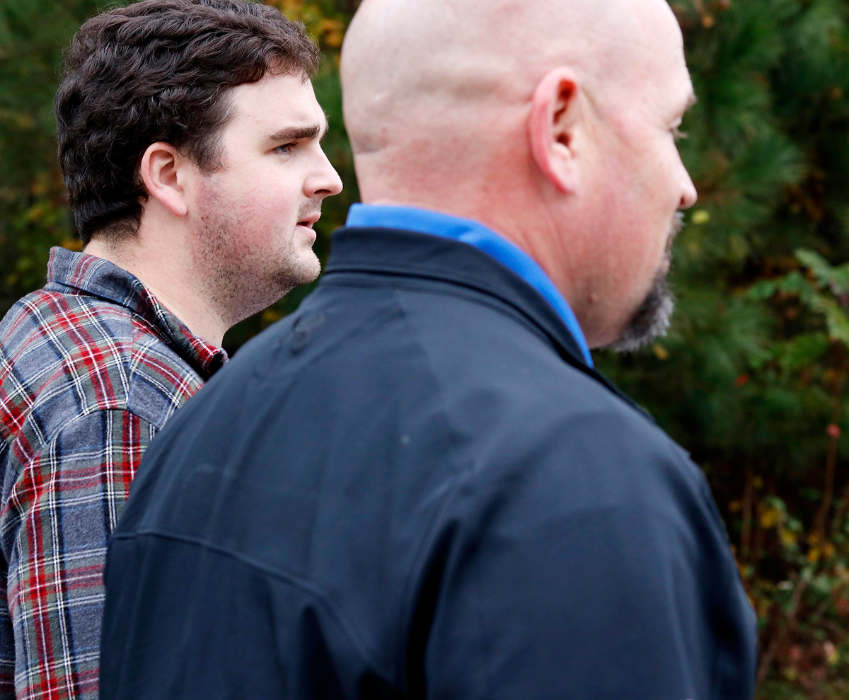 Justin Strength, campaign manager for State House candidate, Marcus Wiedower, walks alongside Wiedower while campaigning in Watkinsville, Georgia on Friday, November 2, 2018. Strength works for War Room Strategies, the company running Weidower's campaign, as the social media director and became campaign manager for Wiedower through that job. (Emily Graven, emilyrgraven@gmail.com)