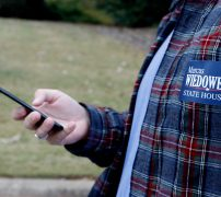 Justin Strength stares at his phone while directing his way through a neighborhood to campaign for Marcus Wiedower on Friday, November 2, 2018, in Watkinsville, Georgia. Strength is a graduate of the University of Georgia and works for War Room Strategies as the social media director as well as campaign manager for Wiedower. (Emily Graven, emilyrgraven@gmail.com)