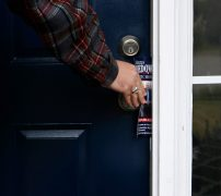Justin Strength, campaign manager for Marcus Wiedower, leaves a flyer at a door on Friday, November 2, 2018, in Watkinsville, Georgia. Strength is organizing the GOTV initiative as Wiedower is running against Jonathan Wallace in the District 119 State House race. (Emily Graven, emilyrgraven@gmail.com)