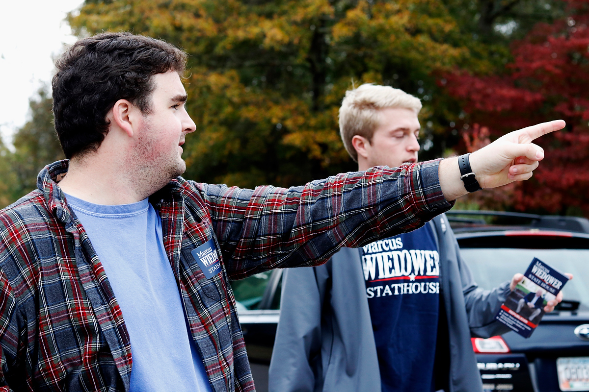 Justin Strength gives directions to team members as they get ready to canvas another street on Friday, November 2, 2018. Strength is looking forward to election night and firmly believes that Wiedower will beat opponent Wallace on election night. (Emily Graven, emilyrgraven@gmail.com)