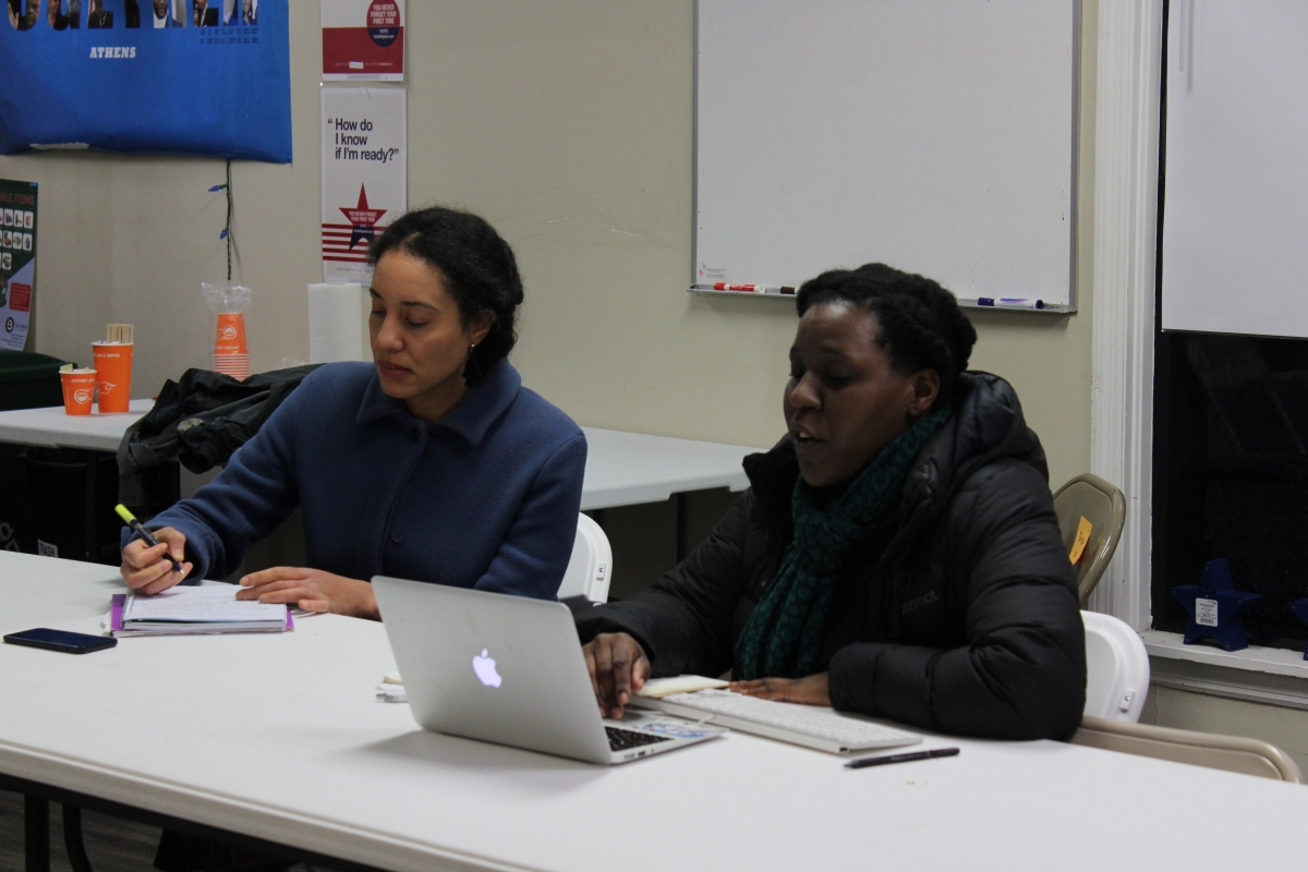 Nnenne Onyioha-Clayton, Athens for Everyone event coordinator, and Rachelle Berry, a University of Georgia doctoral student and prison reform activist, discuss opposition to unpaid prison labor in Athens-Clarke County. (Photo/Raphaëla Alemán)