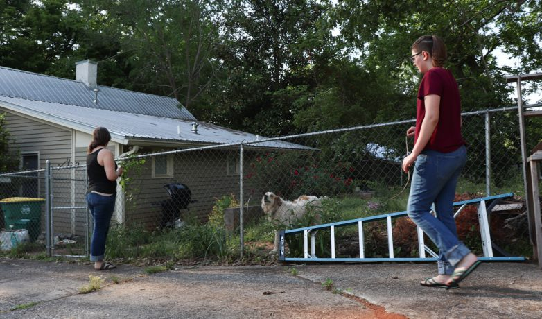 Van Cantfort and Emma walk towards the front of their house on April 23, 2019. Van Cantfort says that the changing temperature in Athens, Georgia, makes it difficult for the plants to survive. (Photo/Mary Martin Harper)