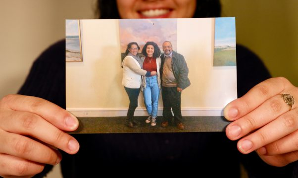 "Amy Guzman-Reyes, 18, visits campus for an all-state band event her junior year of high school on March 4, 2017 with her parents, Rene and Leticia Guzman, to attend freshman orientation. Guzman is the first person in her family to be born in the United States and go to college. ""If you are first-gen, chances are it is not by accident. It took a lot to get here."" Guzman said. (Photo/Alexandra Rios)"