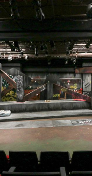 Photograph of the final set for the Department of Theatre and Film Studies's production of In the Blood. The challenge of desinging the set for a play like In the Blood is that since it focuses on homelessness, one has to build a physical space for those who don't have one of their own. (Photo/Anthony Gagliardi)