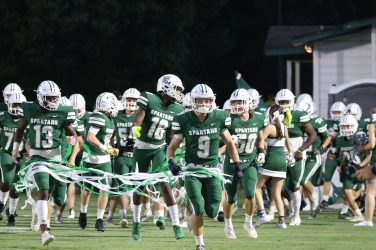 Athens Academy's football team enters the field against Towns County.