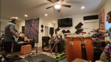 Members of the band Undeground Springhouse rehearse prior to the pandemic.